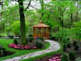 Gazebo, irregular flagstone walkway, plantings flowers shrubs