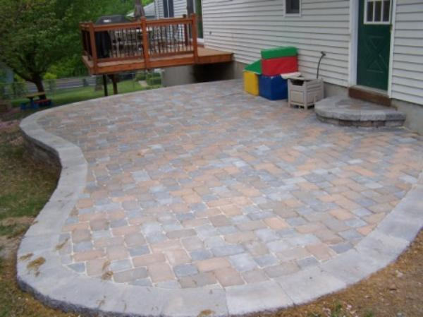 Patio on sloping yard - What to do with a sloped yard ...